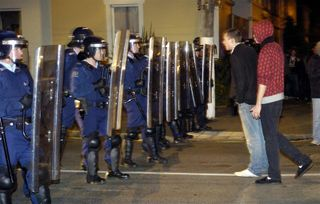 Riot_police_in_the_north_dunedin_student_area_afte_48b0fb98b9