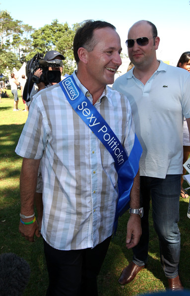 A 20 NZ Politics Daily - Bryce Edwards Otago University liberation blog - www.liberation.org.nz  John Key voted Sexiest Politician is presented with a sash at Big Gay Out on February 13, 2011 in Auckland, New Zealand